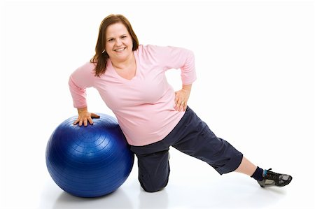 Beautiful plus sized model working out with a pilates fitness ball.  Full body isolated on white. Stock Photo - Budget Royalty-Free & Subscription, Code: 400-04983398
