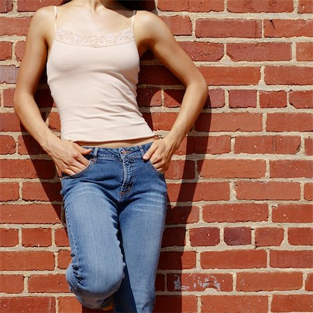 female crotch - Fashionable closeups of womans mid section against brick wall. Stock Photo - Budget Royalty-Free & Subscription, Code: 400-04998332