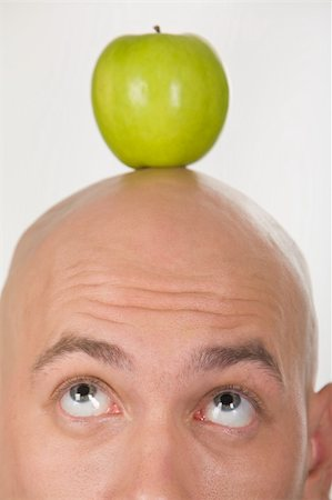 skinhead - Close-up of bald head with green apple on its top Stock Photo - Budget Royalty-Free & Subscription, Code: 400-04999595