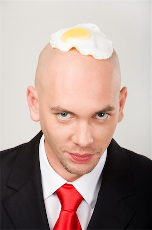 skinhead - Bald man with fried eggs on top of head looking at camera Stock Photo - Budget Royalty-Free & Subscription, Code: 400-04999601