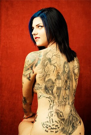 Woman with many tattoos on her back and arms Stock Photo - Budget Royalty-Free & Subscription, Code: 400-04990402
