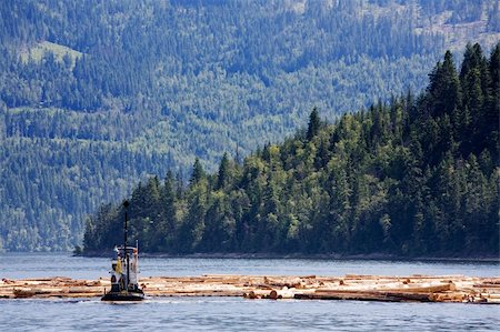 A logging boat on the coast Stock Photo - Budget Royalty-Free & Subscription, Code: 400-04991043