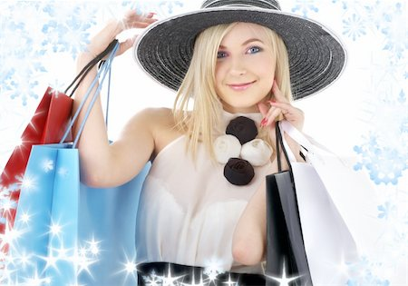 elegant blonde in retro hat with shopping bags Stock Photo - Budget Royalty-Free & Subscription, Code: 400-04992483