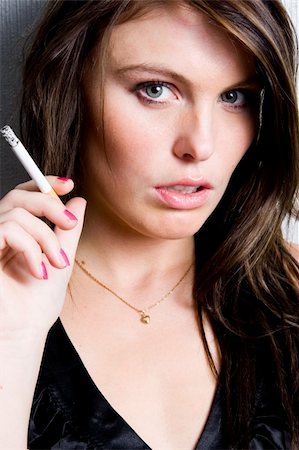 Portrait of beautiful young fashion model smoking a cigarette Stock Photo - Budget Royalty-Free & Subscription, Code: 400-05006333