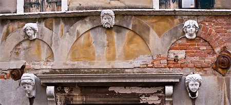 Architectural detail- a series of busts in the facade of a Venetian building. Stock Photo - Budget Royalty-Free & Subscription, Code: 400-05015121