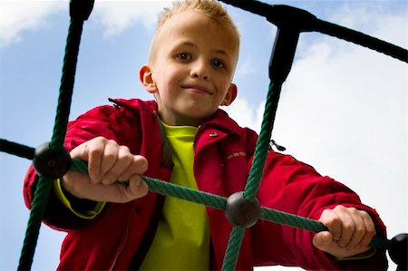 A young boy playing at the playground. Stock Photo - Budget Royalty-Free & Subscription, Code: 400-05018739