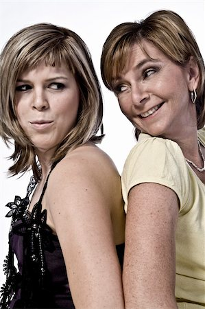 A portrait taken from mother and daughter taken on a white background joking Stock Photo - Budget Royalty-Free & Subscription, Code: 400-05018814