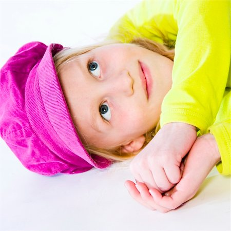a model portrait in the studio of a kid lying down Stock Photo - Budget Royalty-Free & Subscription, Code: 400-05019627