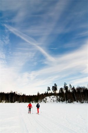 Skiing on a bright sunny day Stock Photo - Budget Royalty-Free & Subscription, Code: 400-05011459