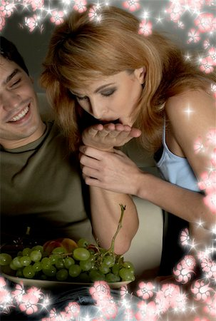 picture of sweet couple eating grapes surrounded by flowers Stock Photo - Budget Royalty-Free & Subscription, Code: 400-05027429