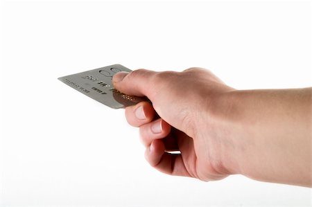 Paying with a credit card, over a white background Stock Photo - Budget Royalty-Free & Subscription, Code: 400-05029002