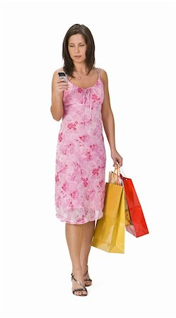 Woman with shopping bags checking her mobile phone. Stock Photo - Budget Royalty-Free & Subscription, Code: 400-05029546