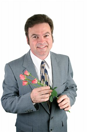 dozen roses - A loving husband holding roses for his sweet-heart. Stock Photo - Budget Royalty-Free & Subscription, Code: 400-05021897