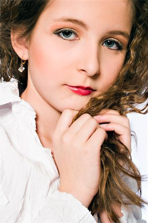 Studio portrait of a young girl made up as a glamourish woman Stock Photo - Budget Royalty-Free & Subscription, Code: 400-05022069