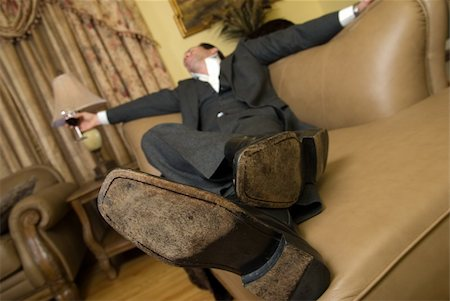 drunk passed out - Man in a business suit sleeping on the sofa with a glass of red wine still in his hand Stock Photo - Budget Royalty-Free & Subscription, Code: 400-05037653