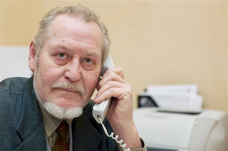 Mature businessman talking on the phone Stock Photo - Budget Royalty-Free & Subscription, Code: 400-05038176