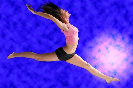 feet gymnast - a cute gymnast in a hard jump on a blue background Stock Photo - Budget Royalty-Free & Subscription, Code: 400-05038982