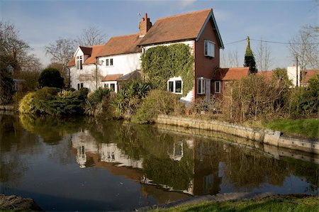 flooded homes - Houses next to canal or river. Stock Photo - Budget Royalty-Free & Subscription, Code: 400-05039295