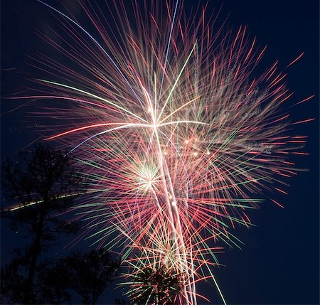 pink and purple fireworks - A great close up of a fireworks finale on the Fourth of July. Stock Photo - Budget Royalty-Free & Subscription, Code: 400-05044950