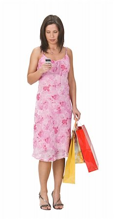 Woman with shopping bags checking her mobile phone. Stock Photo - Budget Royalty-Free & Subscription, Code: 400-05045549