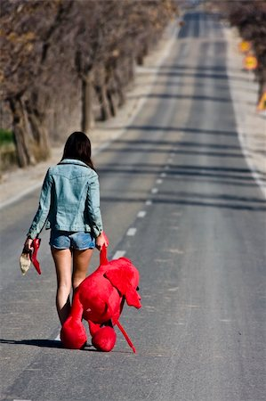 running away scared - Young woman left behind with her teddy bear. Stock Photo - Budget Royalty-Free & Subscription, Code: 400-05040024