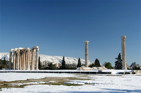 The ancient temple of Olympian Zeus in Athens, Greece, after a snowfall Stock Photo - Budget Royalty-Free & Subscription, Code: 400-05041296