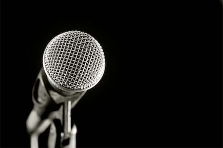 vocal microphone isolated on black Stock Photo - Budget Royalty-Free & Subscription, Code: 400-05057206