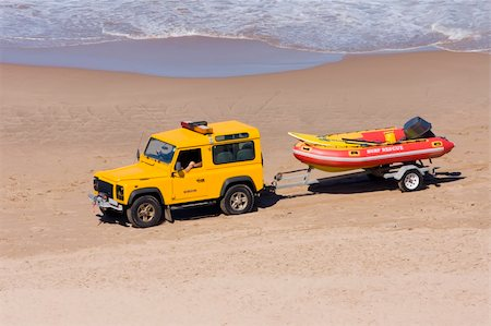 Rescue vehicle towing a rescue rubber dinghy on the beach Stock Photo - Budget Royalty-Free & Subscription, Code: 400-05068637