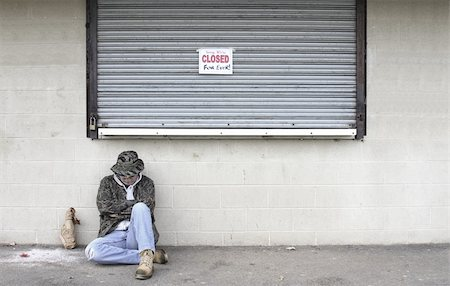running away scared - Man sleeping on the street by a closed business Stock Photo - Budget Royalty-Free & Subscription, Code: 400-05068895