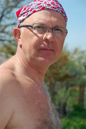 shirtless senior man wearing glasses and kerchief on his head outdoors Stock Photo - Budget Royalty-Free & Subscription, Code: 400-05061668
