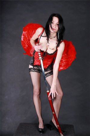 Nasty angel with red wings, sword, leather dress and pantyhose Stock Photo - Budget Royalty-Free & Subscription, Code: 400-05062363