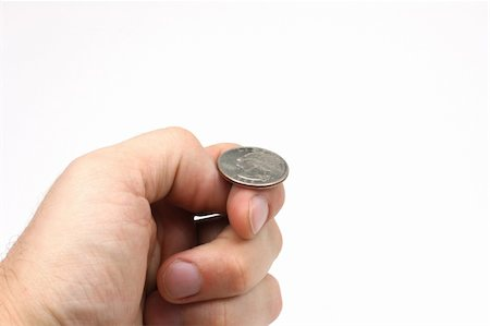 A hand holding a quarter, just about to flip a coin. Stock Photo - Budget Royalty-Free & Subscription, Code: 400-05074627