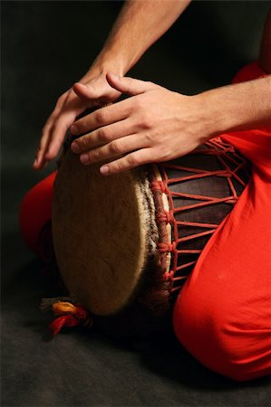 Man playing the nigerian drum in studio Stock Photo - Budget Royalty-Free & Subscription, Code: 400-05078069