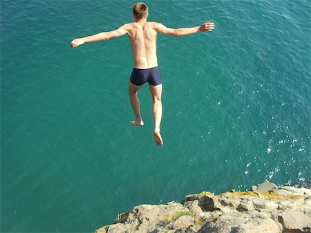 Jump from a high rock in water and swim in the sea Stock Photo - Budget Royalty-Free & Subscription, Code: 400-05078700