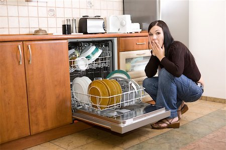 attractive brunette woman cleaning kitchen Stock Photo - Budget Royalty-Free & Subscription, Code: 400-05079665