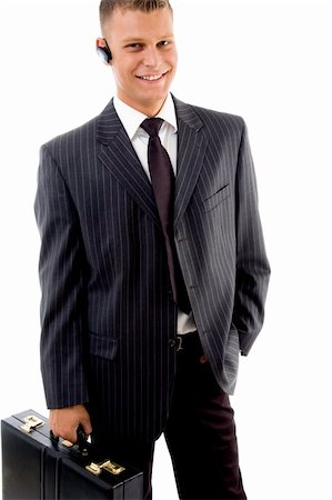 portrait of businessman standing with briefcase on an isolated background Stock Photo - Budget Royalty-Free & Subscription, Code: 400-05084546