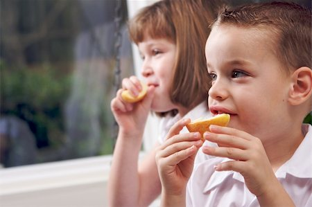 pre-teen boy models - Sister and Brother Having Fun Eating an Apple Stock Photo - Budget Royalty-Free & Subscription, Code: 400-05086667