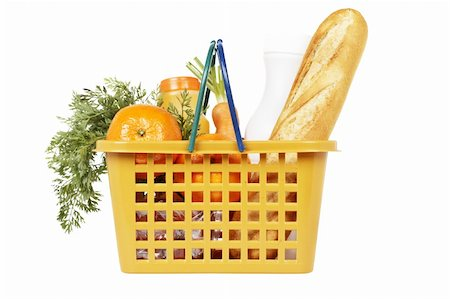 A shopping basket full of groceries isolated on white background Stock Photo - Budget Royalty-Free & Subscription, Code: 400-05088080