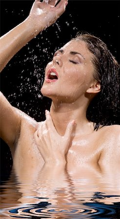 picture of wet brunette girl over black Stock Photo - Budget Royalty-Free & Subscription, Code: 400-05080848