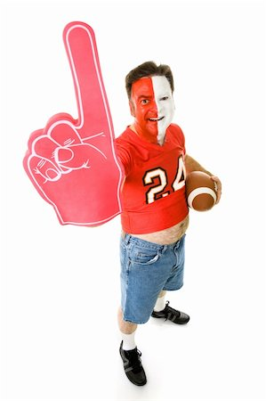 fat man balls - Overweight, middle aged sports fan in a football jersey with a number one foam finger. Stock Photo - Budget Royalty-Free & Subscription, Code: 400-05082209