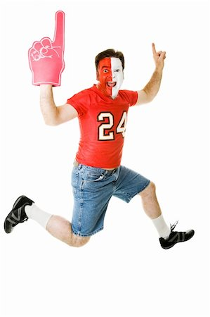 fat man balls - Enthusiastic sports fan jumping for joy over his team's success.  Full body isolated on white. Stock Photo - Budget Royalty-Free & Subscription, Code: 400-05082214
