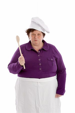 Female chef holding up her wooden spoon with a dangerous face Stock Photo - Budget Royalty-Free & Subscription, Code: 400-05083446