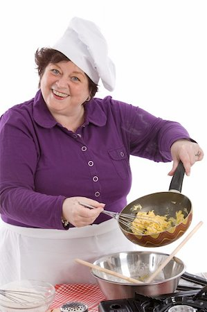 Female chef showing the inside of her frying pan with scrambled egg Stock Photo - Budget Royalty-Free & Subscription, Code: 400-05083447