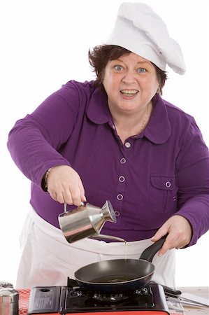 Female chef pouring oil in the pan looking funny Stock Photo - Budget Royalty-Free & Subscription, Code: 400-05083448