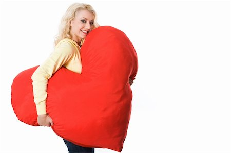 Portrait of pretty young woman with large toy heart giving you fantastic smile Stock Photo - Budget Royalty-Free & Subscription, Code: 400-05090603