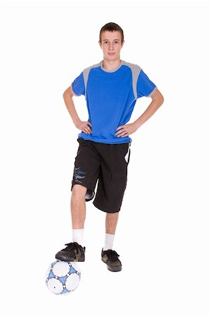 happy teenager playing football. over white background Stock Photo - Budget Royalty-Free & Subscription, Code: 400-05102690