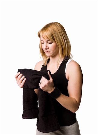 sweaty woman - Girl drying herself with a towel Stock Photo - Budget Royalty-Free & Subscription, Code: 400-05115514