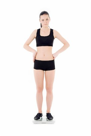 picture of unhappy woman on scales over white Stock Photo - Budget Royalty-Free & Subscription, Code: 400-05111140