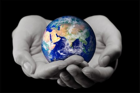 Holding the World (2 hands holding the globe,with a soft DOF on the hands) Stock Photo - Budget Royalty-Free & Subscription, Code: 400-05111557