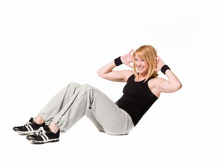 sweaty woman - Woman doing situps Stock Photo - Budget Royalty-Free & Subscription, Code: 400-05112689